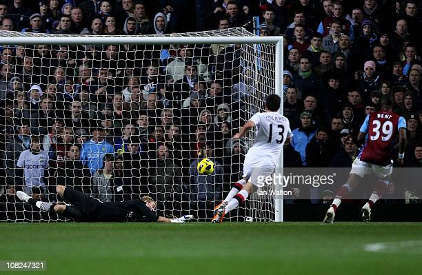Darren Bent of Aston Villa Sscores the opening goal on his debut past Joe Hart of Manchester City during the Barclays Premier League match between...