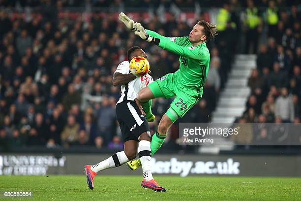 Darren Bent of Derby County has his shot saved by Tomasz Kuszczak of Birmingham City during the Sky Bet Championship match between Derby County and...