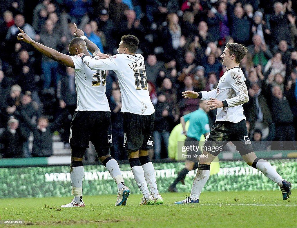 Darren Bent of Derby is congratulated after scoring during the FA Cup fifth round tie between Derby County and Reading at iPro Stadium on February 14, 2015 in Derby, England.