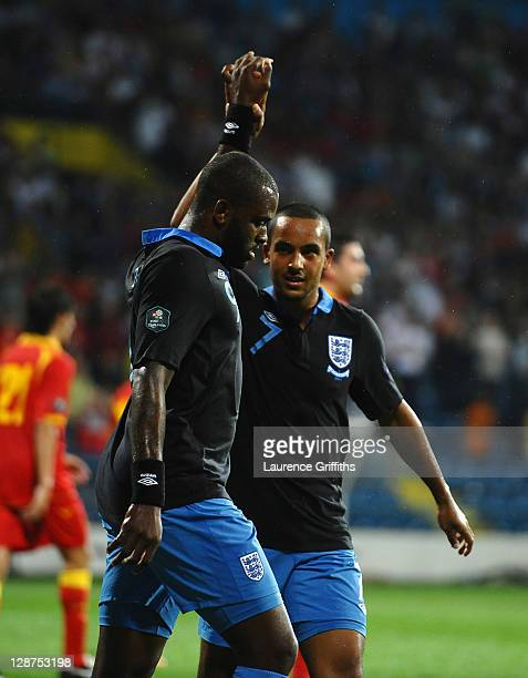Darren Bent of England celebrates scoring his team's second goal with Theo Walcott during the UEFA EURO 2012 Group G qualifier between Montenegro and...