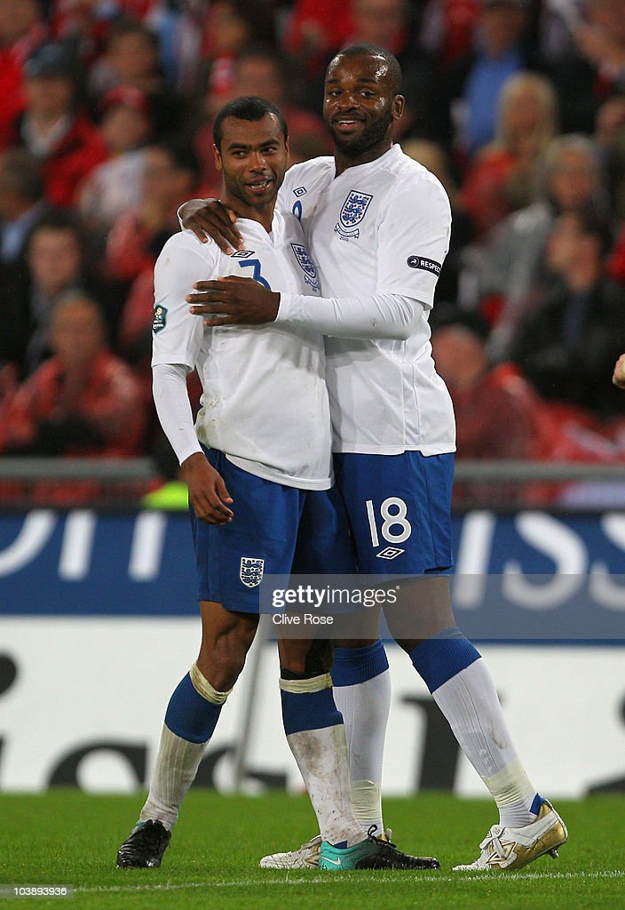 Darren Bent of England celebrates scoring his team's third goal with Ashley Cole during the EURO 2012 Group G Qualifier between Switzerland and England at St Jakob Park on September 7, 2010 in Basel, Switzerland.