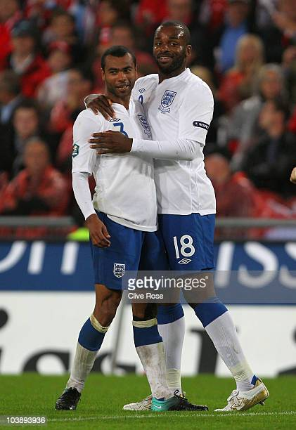 Darren Bent of England celebrates scoring his team's third goal with Ashley Cole during the EURO 2012 Group G Qualifier between Switzerland and...