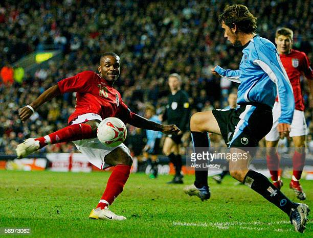 Darren Bent of England is blocked by Diego Godin of Uruguay during the International friendly match between England and Uruguay at Anfield on March 1...