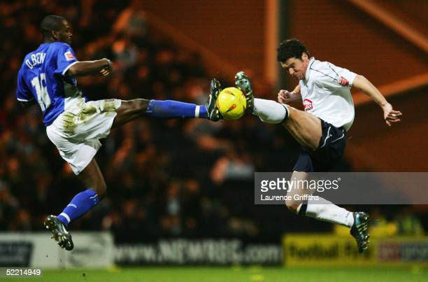 Darren Bent of Ipswich battles for the ball with Brian O'Neil of Preston during the CocaCola Championship match between Preston North End and Ipswich...