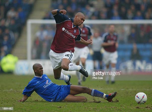 Darren Bent of Ipswich gets tackled by Leon Johnson of Gillingham during the Nationwide first Division match between Gillingham and Ipswich Town at...