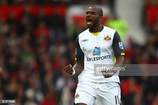 Darren Bent of Sunderland celebrates scoring the opening goal during the Barclays Premier League match between Manchester United and Sunderland at...