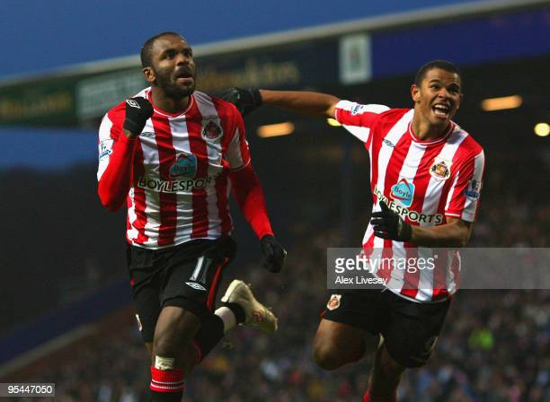 Darren Bent of Sunderland celebrates with Fraizer Campbell after scoring the opening goal during the Barclays Premier League match between Blackburn...