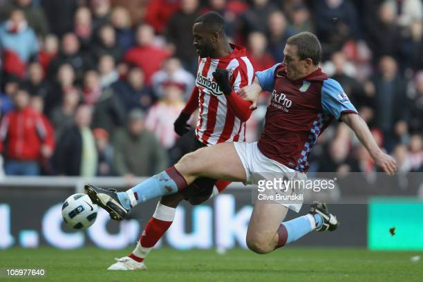 Darren Bent of Sunderland is tackled by Richard Dunne of Aston Villa during the Barclays Premier League match between Sunderland and Aston Villa at...