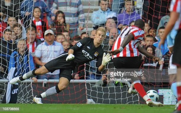 Darren Bent of Sunderland scores a penalty past Joe Hart of Manchester City during the Barclays Premier League match between Sunderland and...