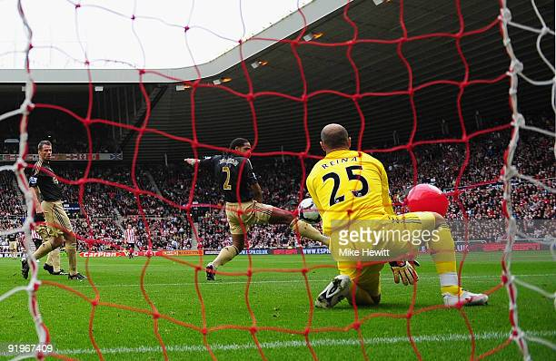 Darren Bent of Sunderland shot on goal deflects off of a balloon as Pepe Reina of Liverpool fails to save the Barclays Premier League match between...
