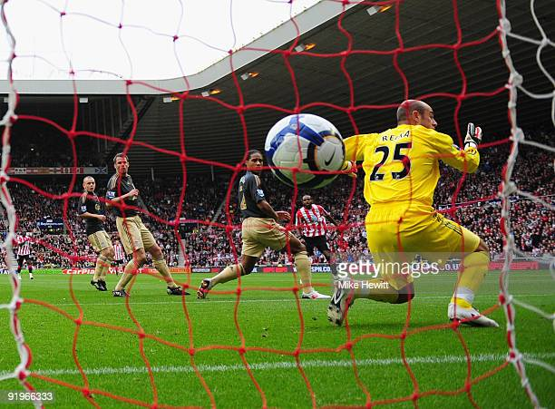 Darren Bent of Sunderland watches as his shot goes between Glen Johnson and Pepe Reina of Liverpool in to the goal during the Barclays Premier League...
