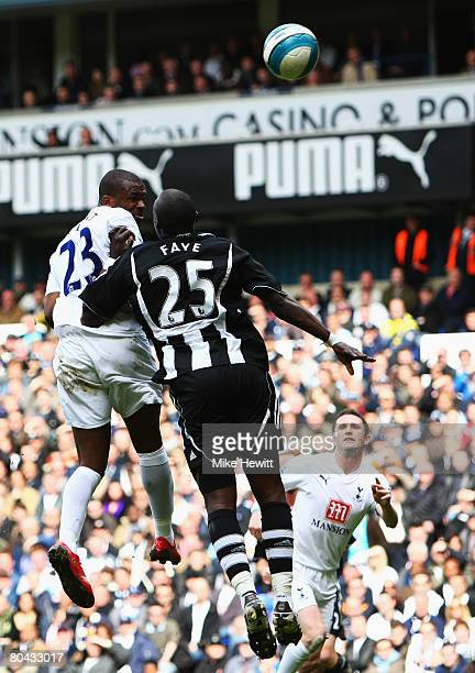 Darren Bent of Tottenham rises above Abdoulaye Faye of Newcastle to score Tottenham's first goal during the Barclays Premier League match between...