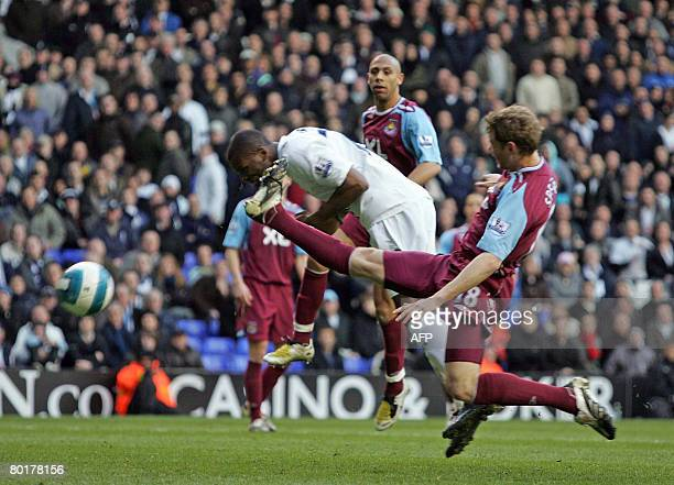 Darren Bent of Tottenham scores his headed goal defended by Jonathan Spector of West Ham during a Barclays Premiership game at White Hart Lane in...