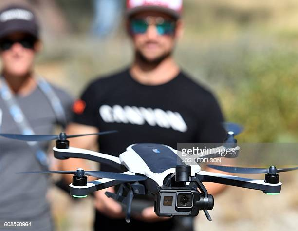 Darren Berreclota pilots a GoPro Karma drone during a press event in Olympic Valley California on September 19 2016 / AFP / JOSH EDELSON