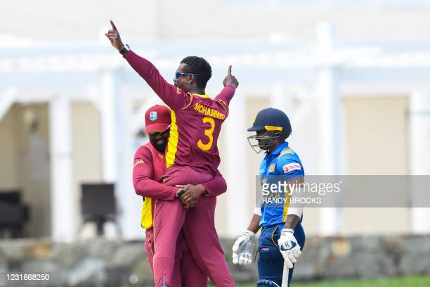 Darren Bravo and Jason Mohammed of West Indies celebrate the dismissal of Ashen Bandara of Sri Lanka during the 2nd ODI match between West Indies and...