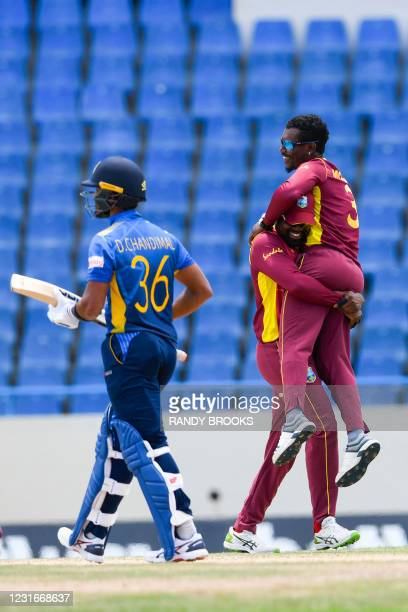 Darren Bravo and Jason Mohammed of West Indies celebrate the dismissal of Dinesh Chandimal of Sri Lanka during the 2nd ODI match between West Indies...