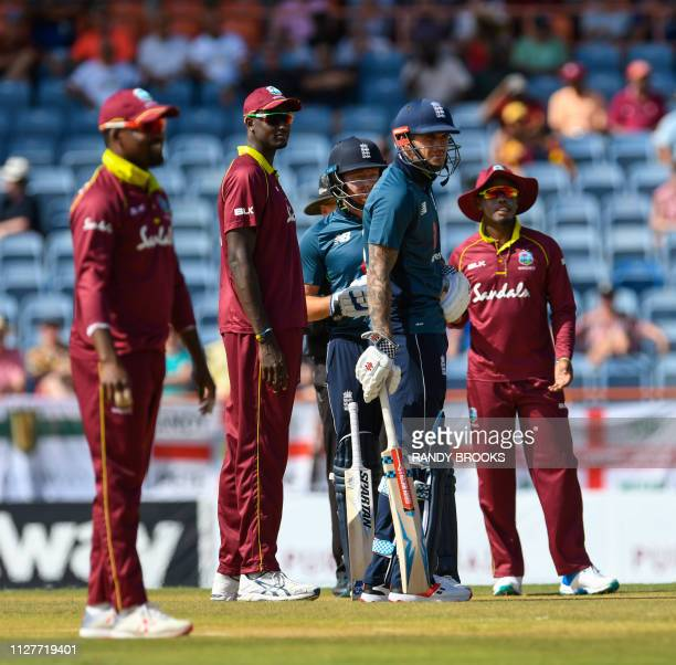 Darren Bravo Jason Holder and Shimron Hetmyer of West Indies Jonny Bairstow and Alex Hales of England wait for the sight screen to change which...