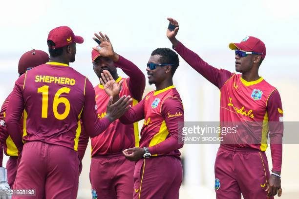 Darren Bravo , Jason Mohammed and Akeal Hosein of West Indies celebrate the dismissal of Ashen Bandara of Sri Lanka during the 2nd ODI match between...