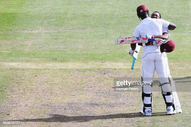 Darren Bravo of the West Indies celebrates scoring 200 runs with Darren Sammy during day four of the first test match between New Zealand and the...