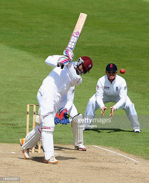 Darren Bravo of the West Indies drives the ball for four runs to bring up his half century during the England Lions v West Indies match at The County...