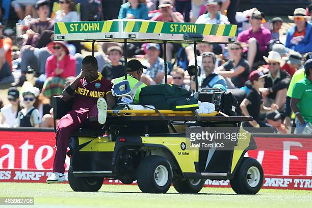 Darren Bravo of the West Indies is carted off the field after injuring himself during the 2015 ICC Cricket World Cup match between Pakistan and the...