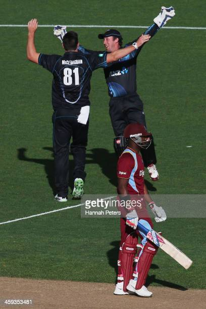 Darren Bravo of the West Indies walks off after being dismissed by Mitchell McClenaghan of New Zealand during the first One Day International match...