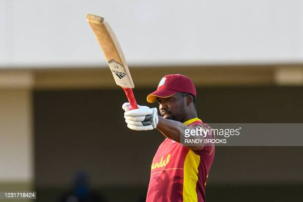 Darren Bravo of West Indies celebrates his century during the 3rd and final ODI match between West Indies and Sri Lanka at Vivian Richards Cricket...