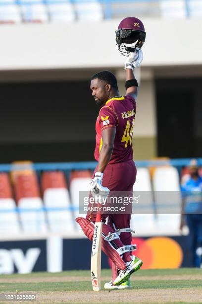 Darren Bravo of West Indies celebrates winning the 1st ODI match between West Indies and Sri Lanka at Vivian Richards Cricket Stadium in North Sound,...