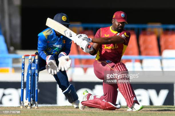 Darren Bravo of West Indies hits 4 during the 3rd and final ODI match between West Indies and Sri Lanka at Vivian Richards Cricket Stadium in North...