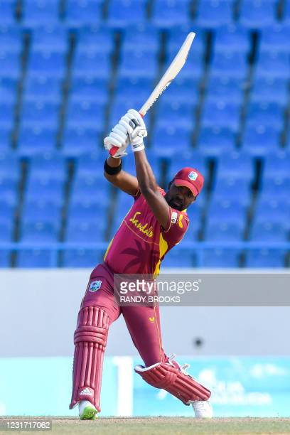 Darren Bravo of West Indies hits 6 during the 3rd and final ODI match between West Indies and Sri Lanka at Vivian Richards Cricket Stadium in North...