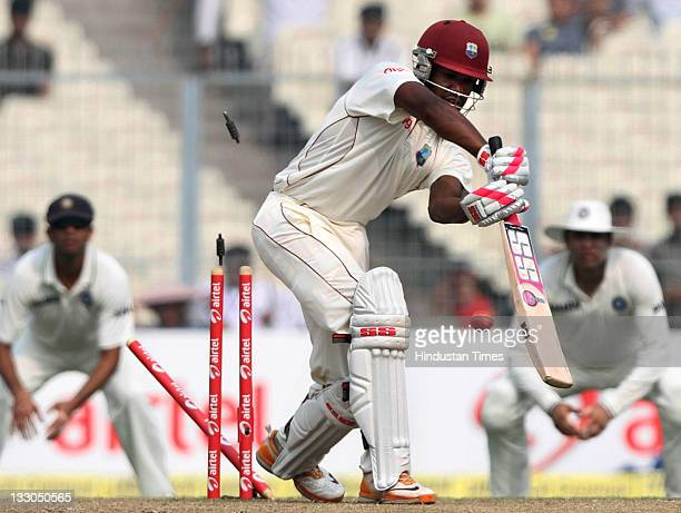 Darren Bravo of West Indies is bowled by Umesh Yadav of India during the third day of second Test Match between India and West Indies at Eden Gardens...
