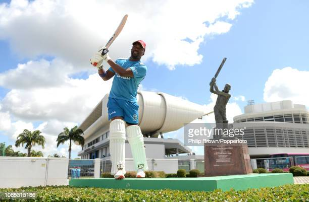 Darren Bravo poses for a photograph in front of the Sir Garfield Sobers statue during a West Indies training session at Kensington Oval on January...