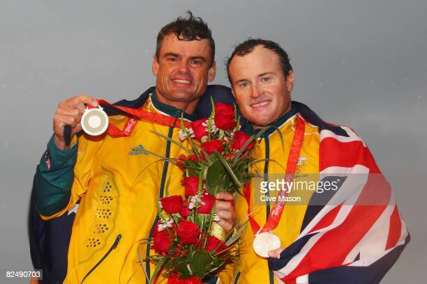 Darren Bundock and Glenn Ashby of Australia receive their silver medals for finishing second in the Tornado class event held at the Qingdao Olympic...