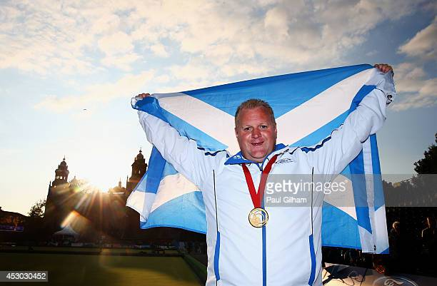 Darren Burnett of Scotland celebrates with his medal after winning the Gold Medal in the Men's Singles Final against Ryan Bester of Canada at...