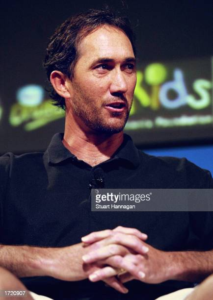 Darren Cahill of Australia and coach of Andre Agassi talks during his interview on the Channel Seven programme 'Talking Tennis' at Melbourne Park in...
