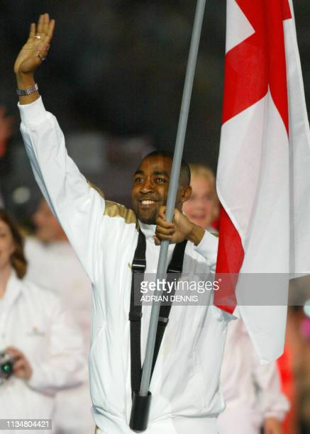 Darren Campbell leads the British delegation as they enter the stadium during the 2002 Manchester Commonwealth Games opening ceremony 25 July 2002...