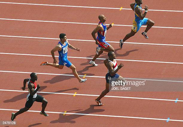 Darren Campbell of the United Kingdom wins heat eight of the men's 200m first round ahead of Brian Dzingai of Zimbabwe Panayiotis Sarris of Greece...