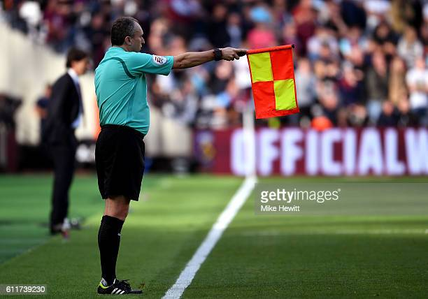 Darren Cann holds his offside flag up during the Premier League match between West Ham United and Middlesbrough at London Stadium on October 1 2016...