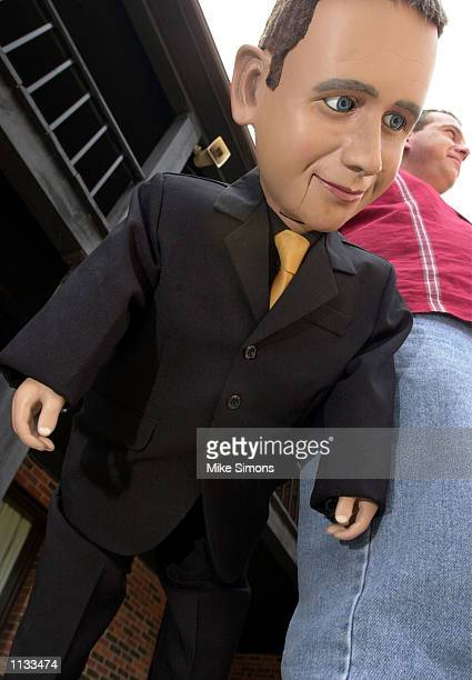 Darren Carr of Australia holds Darrell by his side as he talks with other ventriloquists at the at the VentHaven ConVENTion July 18 2002 in Fort...