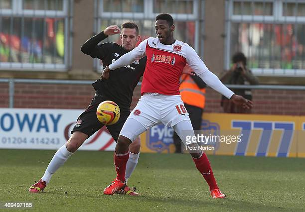 Darren Carter of Northampton Town contests the ball with Jamille Matt of Fleetwood Town during the Sky Bet League Two match between Fleetwood Town...