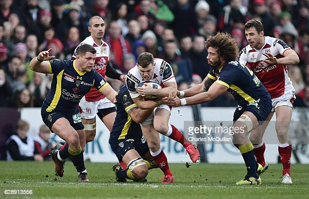 Darren Cave of Ulster and Yohan Beheregaray and Benjamin Kayser of Clermont during the European Champions Cup game between Ulster and ASM Clermont...