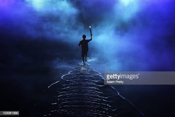 Darren Choy of Singapore carries the Youth Olympic torch before igniting the Youth Olympic Flame at the Opening Ceremony of the 2010 Youth Olympics...