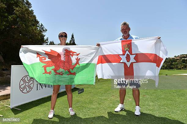 Darren Clarke and Amy Boulden pose with the flags of Northern Ireland and of Wales during The Costa Smeralda Invitational golf tournament at Pevero...