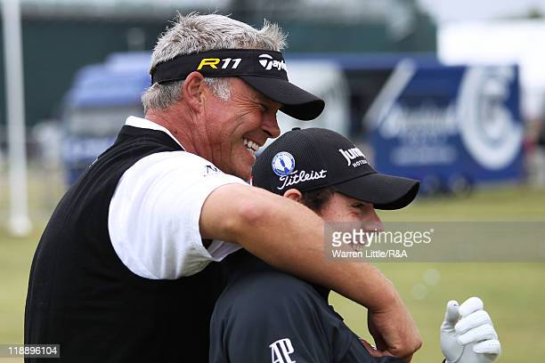 Darren Clarke and Rory McIlroy of Northern Ireland have a laugh on the practice ground during the second practice round during The Open Championship...