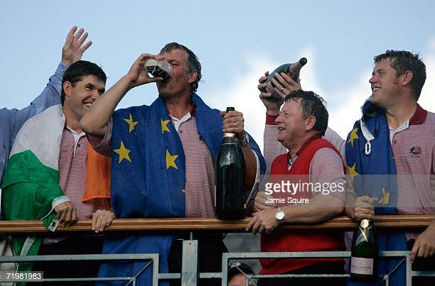 Darren Clarke of Europe celebrates by downing a pint of Guinness on the clubhouse balcony after Europe won the Ryder Cup by a score of 18 1/2 9 1/2...