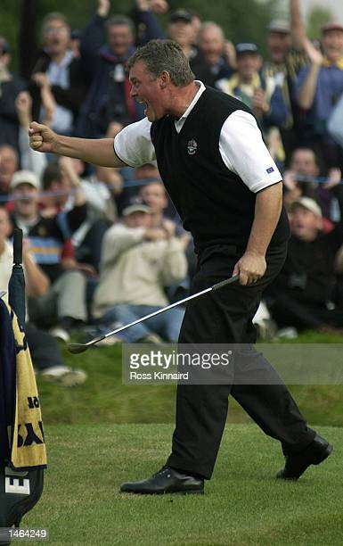Darren Clarke of Europe celebrates his birdie on the 14th to win the hole during the afternoon fourballs on the second day of the 34th Ryder Cup...