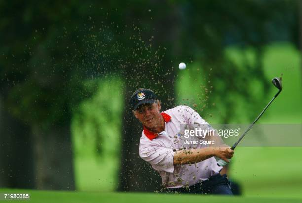 Darren Clarke of Europe hits out of a bunker on the 4th hole during his singles match against Zach Johnson of USA on the final day of the 2006 Ryder...