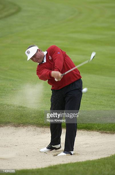 Darren Clarke of Europe plays out from the bunker on the first fairway during the morning fourball matches on the first day of the 34th Ryder Cup at...