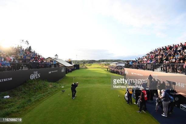 Darren Clarke of Ireland hits the opening tee shot on the 1st hole during the first round of the 148th Open Championship held on the Dunluce Links at...