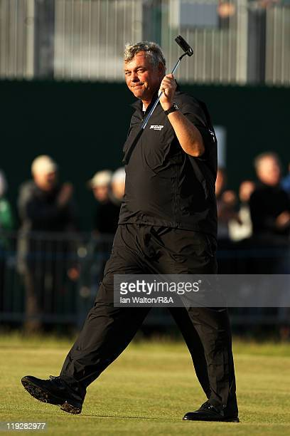 Darren Clarke of Northern Ireland acknowledges the crowd as he walks off the 18th green during the third round of The 140th Open Championship at...